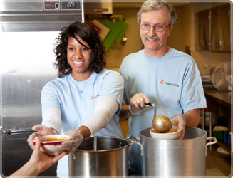 PGN employees working in a soup kitchen